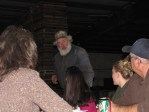 Mark Smith talking to Necia Phillips at Gold Dust's 2012 Holiday Luncheon in Malin, OR.