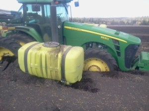 A John Deere tractor stuck in a field at the Running Y Ranch outside of Klamath Falls, Oregon.