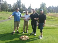 A team photo of Cory Thompson, Howard Klassen, Rich Wright and Eric Jackson at the Running Y Ranch golf course for Gold Dust Potatoes' 2013 Open House Field Day.