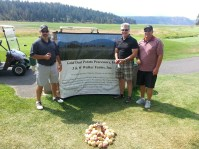 A group photo of Greg Addington, Paul Sproule and Eddie Staunton at Gold Dust Potato Processors' 13th Annual Open House Field Day golf scramble.