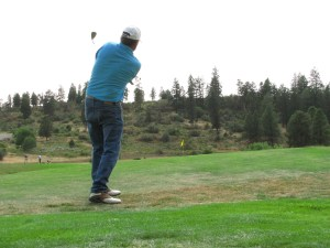 Matt Huffman of Huffman Brothers Farm goes for a birdie at the Running Y Ranch golf course.