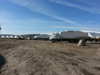 Potato trucks are lined up waiting to unload chipping potatoes into Gold Dust's cellar near Malin, Oregon.