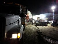 A spud truck unloads chipping potatoes while cellar crews sort through them at a potato cellar near Malin, OR