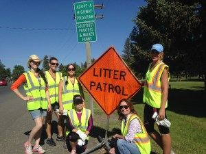 """Lexi Crawford, Trish Briones, Sarah Mendez, Nayeli Pena, Lisa Mount and Danell Hoppezak pose with the """"Litter Patrol"""" sign near the Malin Park for Gold Dust's Highway Clean Up."""