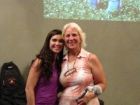 Peggy Devine poses with Lexi Crawford while accepting the women's longest drive award at Gold Dust's 2014 Open House Field Day golf scramble held at the Running Y Ranch golf resort.