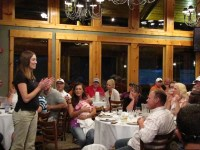 Katie Walker applauding the audience for their generosity for Make-A-Wish Oregon at the dinner for Gold Dust's Open House Field Day.