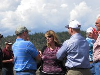 Tricia Hill talks to representatives during the field tour at the Running Y Ranch during Gold Dust's Open House Field Day.