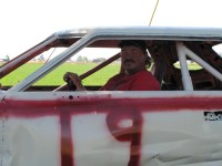 Don Sconce sits in the driver's seat of a demolition derby car before the 2014 Tulelake Butte Valley Fair.