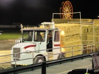 Toby Turner moves a unit of hay at the 2014 Tulelake Butte Valley Fair hay squeeze competition.