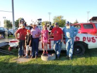 Tristen Wilson, TJ Chavez, John Walker, Emma Chavez, Don Sconce and Mark Smith pose with the Gold Dust demolition derby car at the 2014 Tulelake Butte Valley Fair.