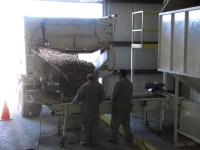 Chipping potatoes being unloaded from a potato truck into Gold Dust Potato Processors' packing shed in Malin, OR.