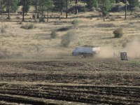 A spud truck leaves a chipping potato field with its first load of the day.