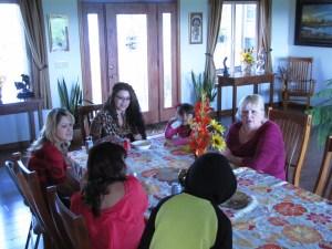 Jan Walker visits with Nayeli Pena, Nancy Hernandez and Mayra Martinez at Gold Dust's Potato Feast.