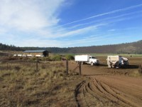Walker Brothers' potato trucks park while waiting for potato harvest to begin on the Running Y Ranch.