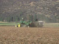 A potato bulker digging potatoes in the Elk Field on the Running Y Ranch.