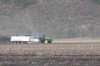 A bulker loads a potato truck in a spud field at the Running Y Ranch near Klamath Falls, Oregon.