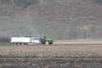 A bulker loads a potato truck in a spud field at the Running Y Ranch near Klamath Falls, Oregon.