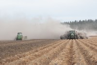 Two tractors prepare a chipping potato field for harvest at the Running Y Ranch outside of Klamath Falls, OR.