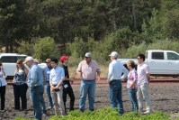 Bill Walker, Gold Dust's CEO, talking to guests in a potato field on the Running Y Ranch during the 15th Annual Open House Field Day.