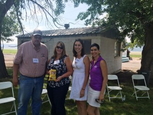 Bill Walker, Tricia (Walker) Hill, Katie Walker and Lexi Crawford pose with a bag of Lay's potato chips at the Running Y Ranch headquarters.