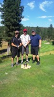 Billy Conrad, Vern Frederickson and Phil Browning at the Running Y Lodge golf course during Gold Dust's 2015 Open House Field Day Golf Scramble.