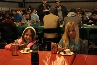 Tricia Hill's daughters, Mari and Rory, join the Gold Dust and Walker Brothers crews for lunch at the 2015 Holiday Luncheon in Malin, OR.
