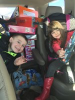 Walker and Penny Crawford, children of Bart and Lexi Crawford, pose with toys gathered for Gold Dust's 2015 Toy Drive for the local Toys For Tots.