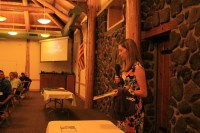 Katie Walker, Weston's wife, talks to Gold Dust's guests about Make-A-Wish at Reames Golf and Country Club.