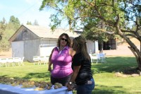 Tricia Hill from Gold Dust and Destiny Huffman of MD Huffman Farms visit during the lunch break at the 16th Annual Open House Field Day.