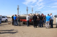 Guests look at a 2016 Harriston Dirt Eliminator and Sizer at Gold Dust's Malin, Oregon campus.