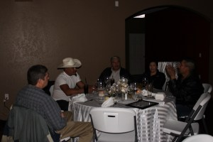 David Petersen, Trino Zendehas Rodriguez, and Salvador and Alma Vera listening to Felimon Zendejas Acosta tell a story after the 2016 Leadership Dinner.