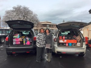 Tricia (Walker) Hill and Lexi Crawford delivering toys to the Toys for Tots program.