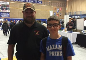 Gold Dust and Walker Brothers employee Toby Turner standing in Mazama High School for the 2017 Mazama College & Career Fair.