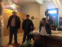 Gold Dust CEO Bill Walker and Plant Manager Matt Thompson thank the potato packing shed crews for their dedication to safety while Nayeli Pena translates during a lunch celebration at Bigoni's Pizza Barn in Malin, Oregon.