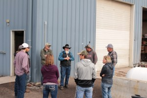 Klamath Community College's ARE 221 Agriculture Marketing class with John Walker and Bart Crawford at Walker Farms' Merrill, Oregon mechanical shop.