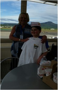 Make-A-Wish wish grantor Jan Walker with Krue Johnston showing off In-N-Out t-shirt and hat donated along with dinner by Medford, Oregon's In-N-Out store manager.