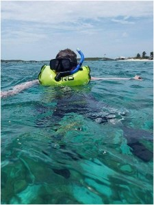 Krue Johnston snorkeling in the Bahamas as part of his wish granted by Make-A-Wish.