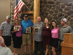 Bart Crawford, Tricia Hill, Bill Walker, Weston Walker, Katie Walker, Lexi Crawford and Matt Thompson with plaques from Make-A-Wish recognizing the fundraising Gold Dust and Walker Farms has done.