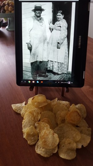 "A photo of the brother and sister team credited with creating the potato chip, George ""Crum"" Speck and Catherine ""Aunt Katie"" Wicks, with their creation, potato chips."