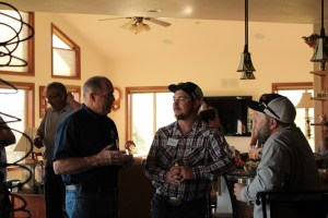 Bob Gasser, Drew Huffman and Kyle Patterson visiting at Bill and Jan Walker's Malin, OR home.