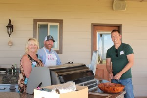 Jan Walker, Ken Hibberd and Casey Lammers prepping dinner near Malin, Oregon.