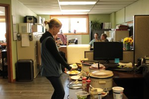 Gold Dust Potato Processors employee Suzanne Wallace fixing a baked potato at the company's potato potluck.