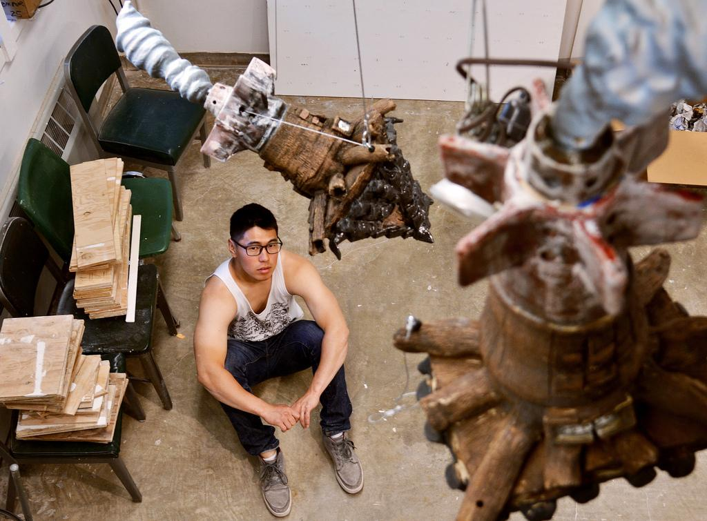 "SF State studio art major Nick Oh addresses Asian American stereotypes through self portraits he calls ""bomb houses"".  These sculptures are made to present the conflict of stereotypes between North Koreans and South Koreans.  Photo by Samantha Benedict / Xpress"