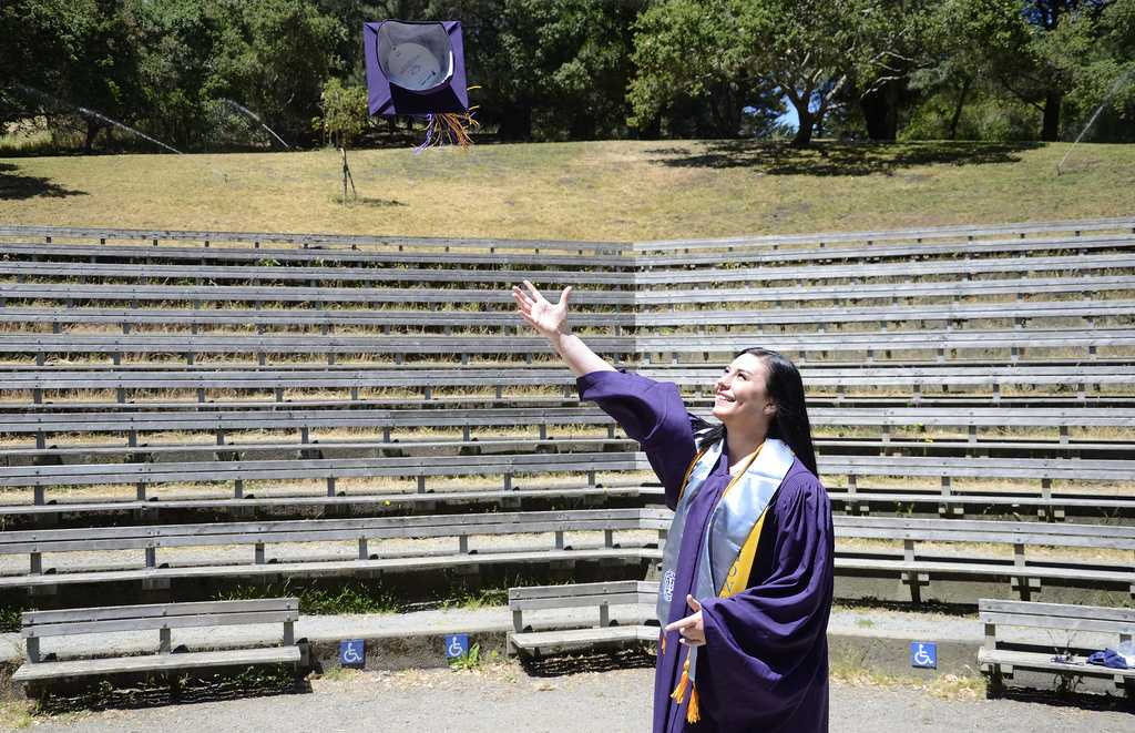 Lea Lunden, soon-to-be SF State psychology graduate, stands in the Jerry Garcia Amphitheater in McLaren Park. This amphitheater is the alternate location for the psychology department's graduation on Saturday, May 25 for SF State psychology students. This graduation, thought up and organized by Lunden, is not supported by the department and tickets for this ceremony are $15 rather than the $85 for the ceremony that will be held on the Hornblower. Photo by Virginia Tieman / Xpress