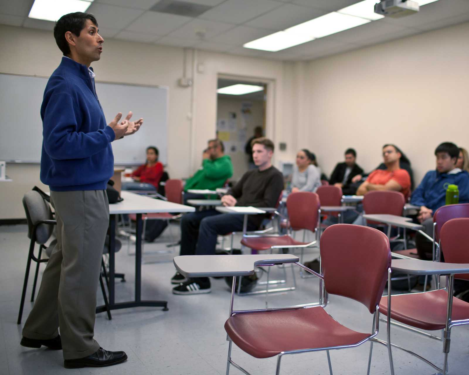 Michael Santos speaks in front of Kelly Carroll's criminal law class at SF State on Wednesday, Nov. 6, 2013. Santos started teaching at SF State in August, 2013 after he was released from a 26-year prison sentence where he earned his degree, and got married. Photo taken by Dariel Medina / Xpress
