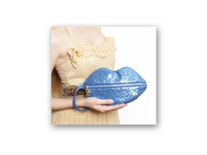 Win a Romantic Sequined Sealed with a Kiss Clutch