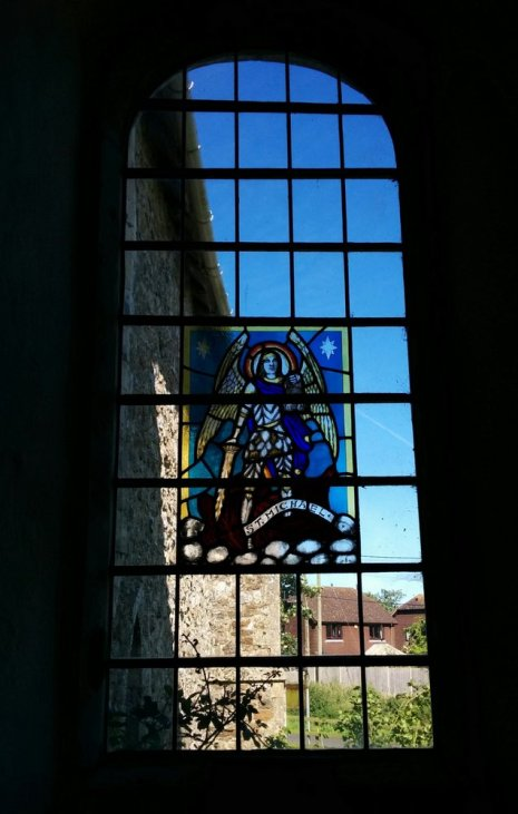 Stained glass wondow in St Mary in the Marsh