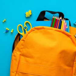 backpack with school supplies coming out