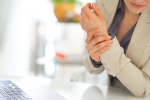 Closeup on business woman with wrist injury