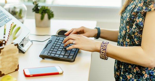 employee using ergonomic keyboard